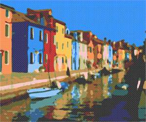 Brightly-painted houses along the Venetian Lagoon in the small city of Burano.