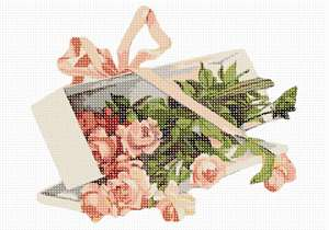 A flower box tied with a pretty bow and overflowing with roses.