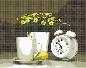 An alarm clock, cup of coffee and a banana await you in the morning.  The potted daisies add serenity to the scene.