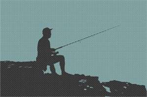 Fishing in silhouette while sitting on the rocks