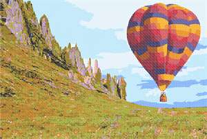 A hot air balloon in brilliant colors hovers over the lush valley. Hot air balloons work because hot air rises. By heating the air inside the balloon with the burner, it becomes lighter than the cooler air on the outside. This causes the balloon to float upwards, as if it were in water. Obviously, if the air is allowed to cools, the balloon begins to slowly come down.