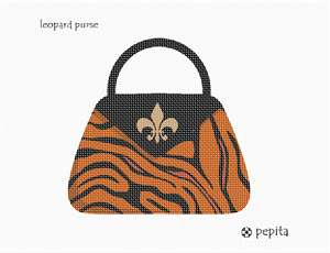 A leopard purse in needlepoint.  This trendy needlepoint pocketbook is fastened with a fleur de lis design.