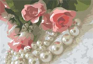 Pearls surround roses on a lace background.  A feminine touch.