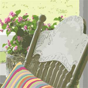 Relax with this rocking chair and floral arrangement