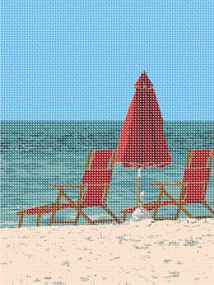 Abandoned red beach chairs with a closed beach umbrella waiting for beach goers.  Go relax in the sun where all you hear are waves crashing and seagulls screeching.