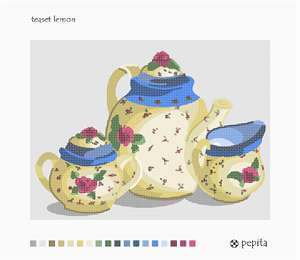 A matching set of florally decorated china: one for tea, one cream, and one sugar, in shades of lemon and blue.