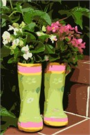 Plants thrive in a pair of boots vase
