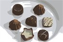 Assorted swiss chocolate bonbons isolated on a white plate.