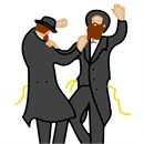 Two hasidic men dancing with joy.