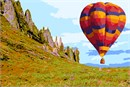 A hot air balloon in brilliant colors hovers over the lush valley.