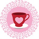 A cup of tea emblazoned with a pink heart against a lacy doily
